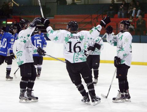 Oxford City Stars celebrate after Nick Oliver (right) doubled their lead against Basingstoke Buffalo