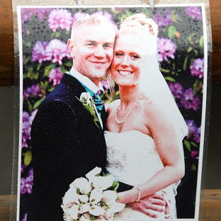 A picture left at the scene in Hanham, near Bristol, in tribute to Ross and Clare Simons