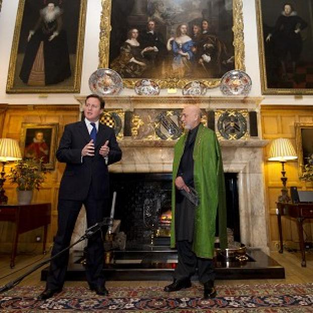 David Cameron and Hamid Karzai are to meet at Chequers