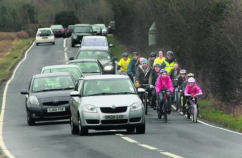 Campaigners cycling along the busy B4044 near Farmoor