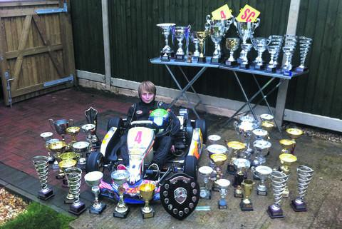 Elliot Harvey with the fruits of his success in karting