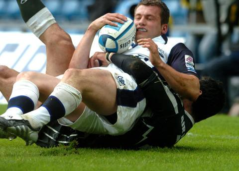 Mark Cueto after scoring a try during Sale's European Challenge Cup final victory over Pau at the Kassam Stadium in 2005