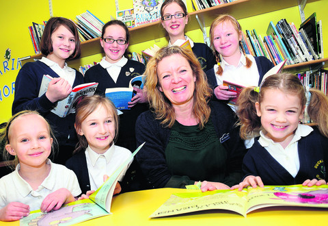Ducklington Primary School teacher Charlie Marshall with, front, Elizabeth Williamson, six, Poppy Fellows, seven, and Charlotte Halls, seven, and, back, Charlotte Dickson, 11, Rhianna Gibson, 11, Katie Procter, 11, and Anya Jarvis, ten. Picture: OX57464