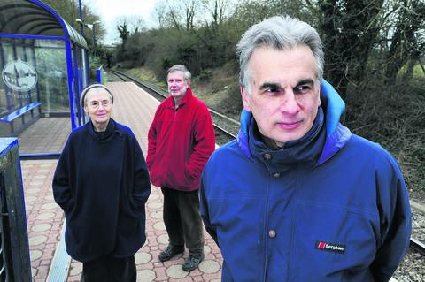 Rail campaigner Ian East, right, at Islip with residents Henrietta Leyser and Colin Tuffrey