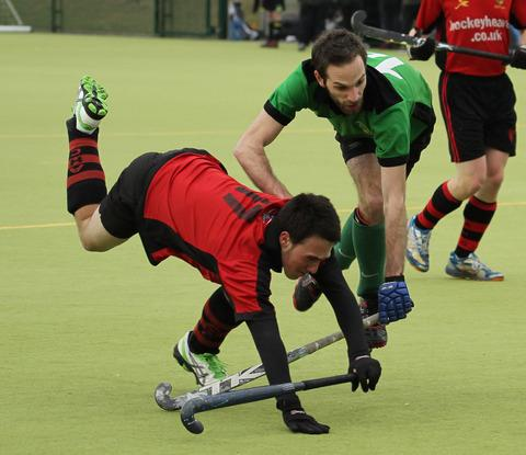 Bicester men's Luke Smith (right) brings down an opponent as he attempts to attack the Ashford goal during Saturday's 1-0 victory