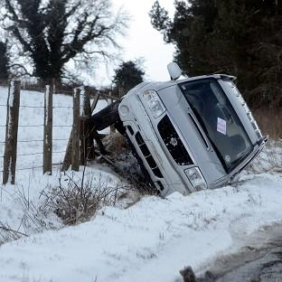A car lies in a ditch after overnight snow in Hexham, Northumberland