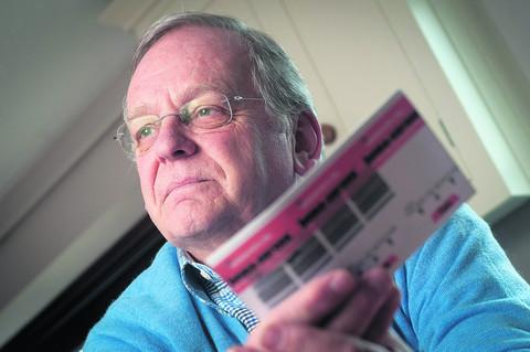 GRATEFUL: Adrian Hampshire with a copy of the bowel cancer test that came through the post and  ended in an operation