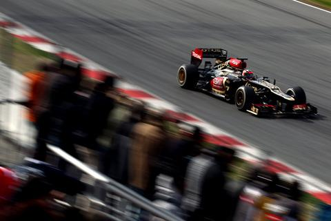 Kimi Raikkonen puts the new Lotus E21 through its paces in practice
