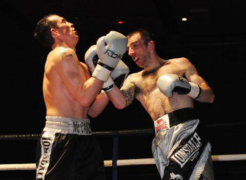 Bicester fighter Daza Usher (right) lands a punch on his way to a single-point victory against Kevin McCauley at Swindon's Oasis Leisure Centre on Saturday to make it five professional wins out of five