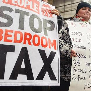 Protestors take part in a demonstration outside Croydon Town Hall in Surrey, against the government's proposed 'bedroom tax'