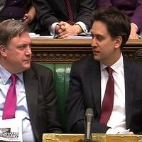 Labour party leader Ed Miliband and the shadow chancellor Ed Balls exchange glances as Chancellor George Osbourne delivers his Budget
