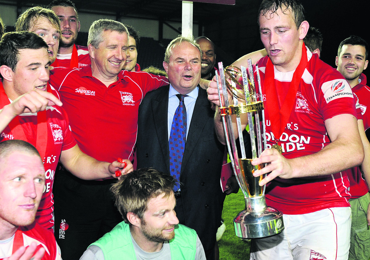 London Welsh chairman Bleddyn Phillips celebrates winning promotion into the Aviva Premiership with captain Jon Mills and coach Lyn Jones