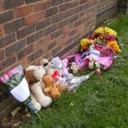 Flowers and cuddly toys left at scene