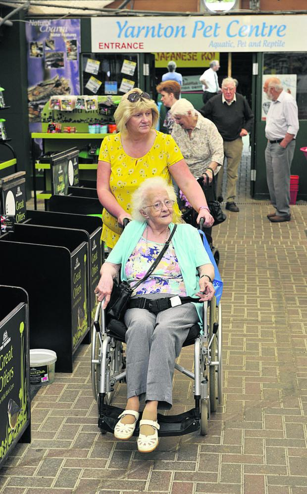 Bicester Advertiser: Elms Day Centre team leader Sheena Wiltshire takes Phyllis Munden, 94, and others on a visit to Yarnton Nurseries Garden Centre