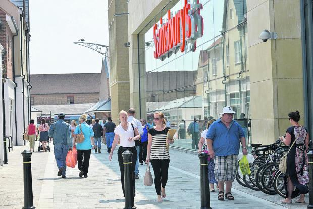 Shoppers walking through the new Pioneer Square in Bicester town centre