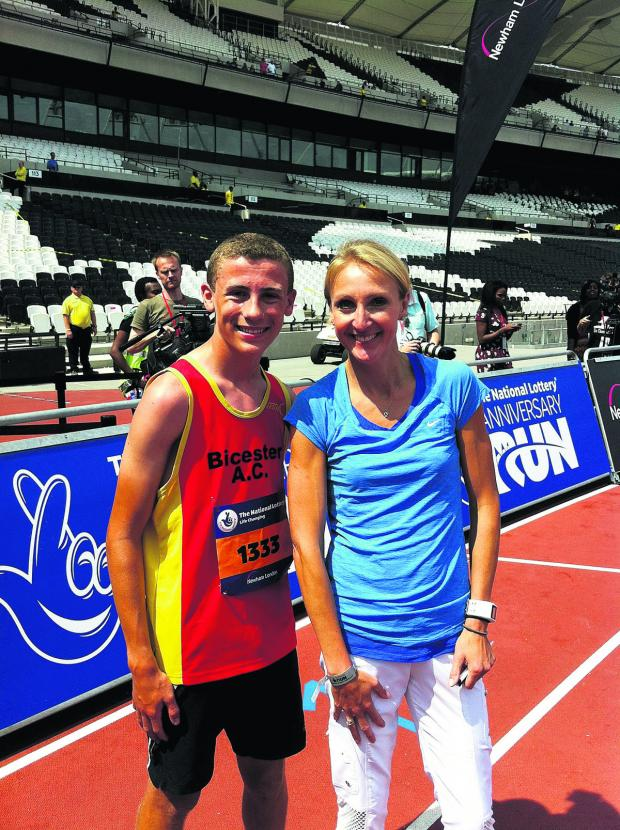 Bicester's Tom Gould is congratulated by women's marathon world record holder Paula Radcliffe after competing at the Olympic Stadium