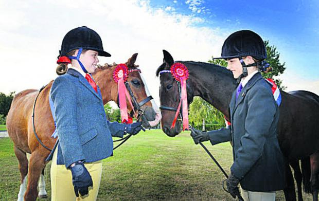Prize-winning Lucie Oakey, left, with her pony Robbie and Eloise Burden with Annie who won an in-hand championship at Haddenham Show. Pictures: OX61689 Simon Williams