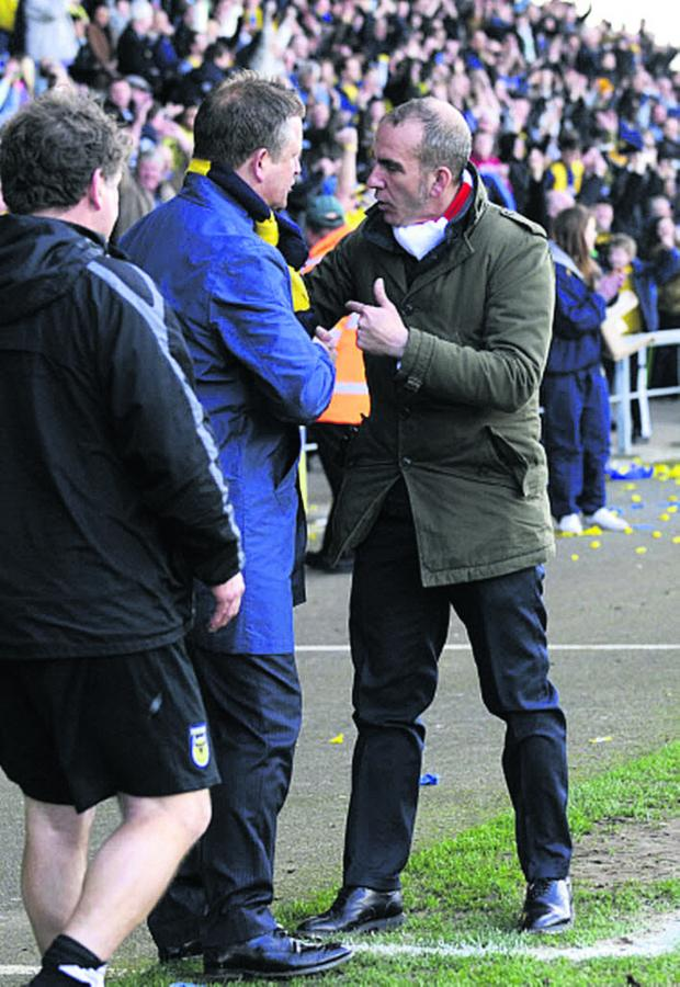 Bicester Advertiser: Paolo Di Canio has words with Oxford United boss Chris Wilder at the Kassam Stadium in March 2012 during his spell at Swindon