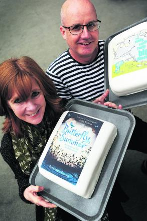 Winners Richard Byrne and Anne-Marie Conway with their winning books represented by cakes