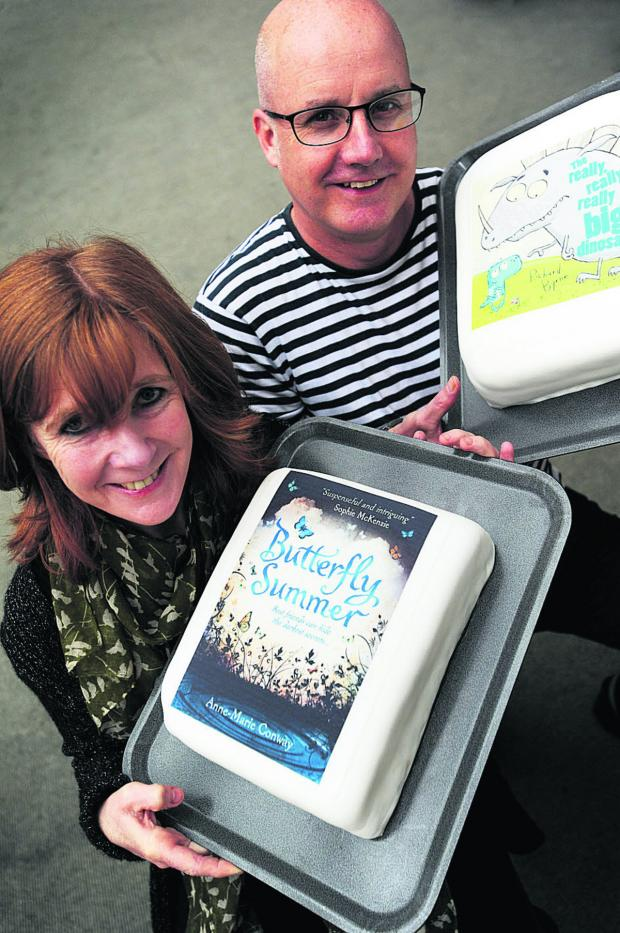 Bicester Advertiser: Winners Richard Byrne and Anne-Marie Conway with their winning books represented by cakes