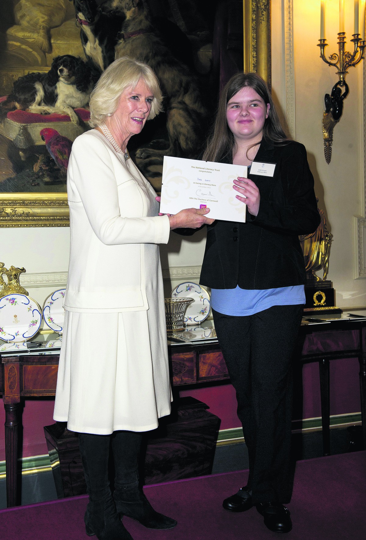 WELL DESERVED: The Duchess of Cornwall presents Jodie Evans with her Literacy Award at Clarence House, London on Wednesday