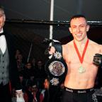 Bicester Advertiser: Richard Buskin after winning the lightweight UFW champion belt
