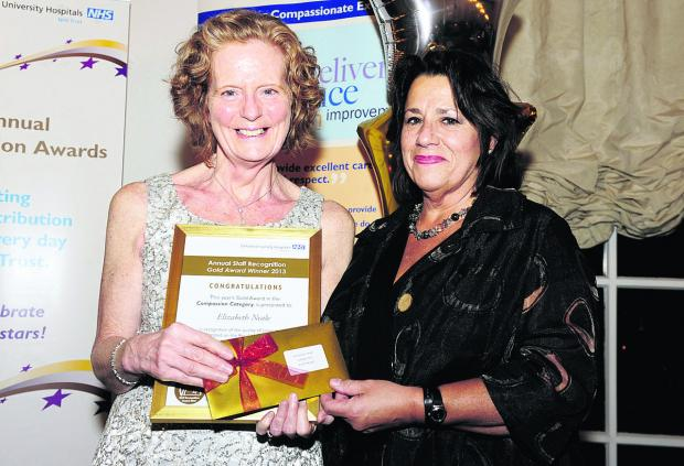 Liz Neale, left, receives her award from acting chief nurse Liz Wright
