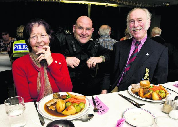 Sgt Colin Travi with Dee and Tony Paddy at the lunch. Picture: OX63963 Antony Moore