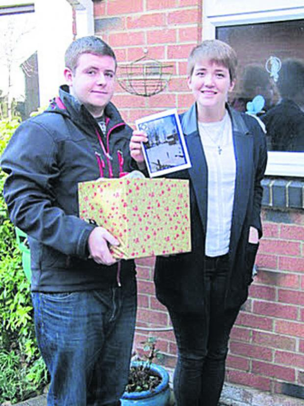 Bicester Advertiser: Students Gemma Pugh and Carl Bartlett, of Cooper School, deliver a hamper
