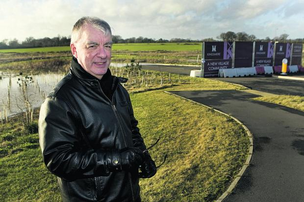 Bicester town council leader James Porter at the planned park-and-ride site near the A41