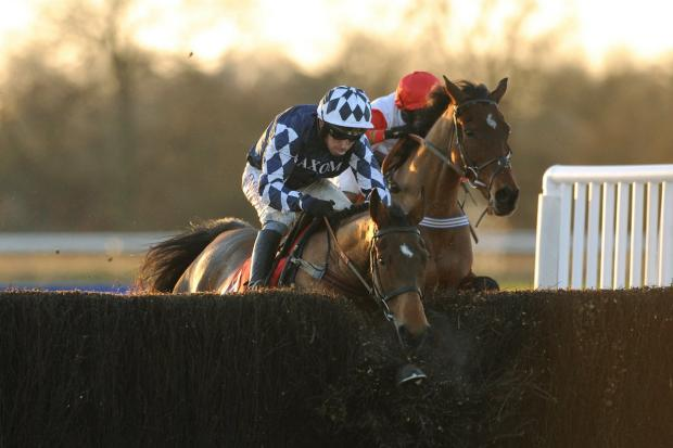 Bicester Advertiser: Carruthers (right) battles it out with Shotgun Paddy, who ploughs through the last before winning the Betfred Classic Chase