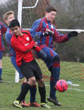 Barton's Sulayman Meah (left) is denied by Blewbury's Charlie Holme-Turner. However, Meah had the last laugh with a hat-trick in his side's 7-0 victory in the Under 14 D League