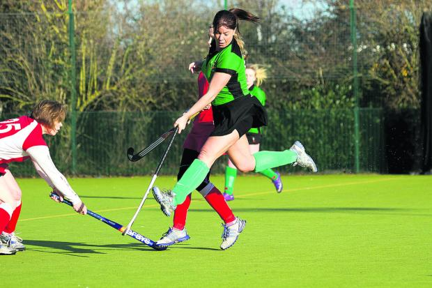 Bicester Ladies' 3rd's Louise Walker leaps high to avoid the ball during their 6-2 defeat at home to Marlow 4th
