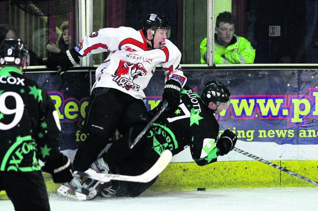 Oxford City Stars head coach Darren Elliott gets hit in the back by Andrew Robinson    Picture: Nicky Craft