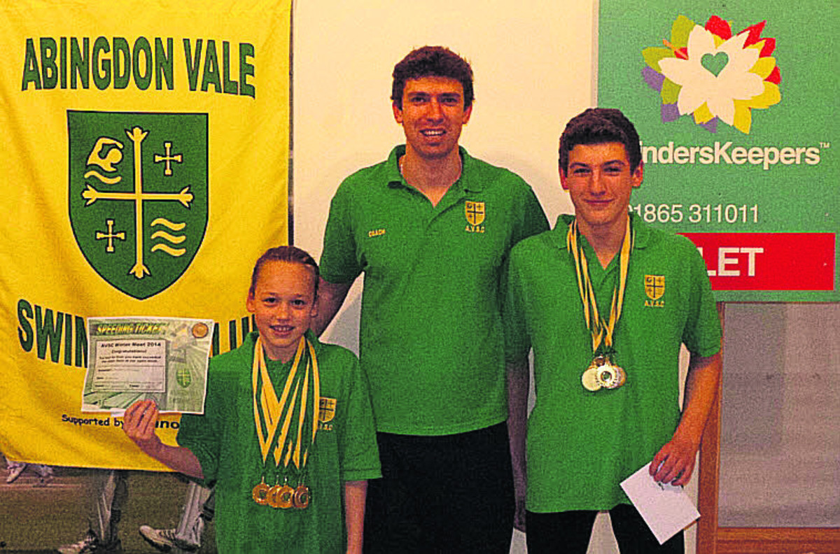 Abingdon Vale's multiple winners Merel Hijink (left) and Daniel Mowlem with their medals and coach Scott Farnell