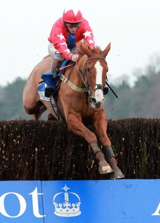 Sire De Grugy and Jamie Moore clear the last fence