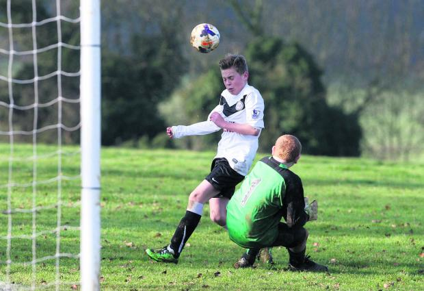 Greater Leys  Under 14 keeper Trevor Holloway does enough to stop Wheatley's hat-trick hero this time