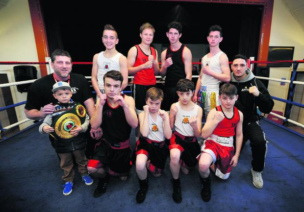 Bicester Advertiser: Youngsters from the Windrush show. Standing (from left): Nathan Hall, Lewis Townsend, Harry Connors, Tommy Connors. Front: Harrison Greeves, Zack Ryerson, Shaun Callaway, Jimmy Doran. Pictured with coach Joe Bugner (left) is Hayden, son of Kelvin Young