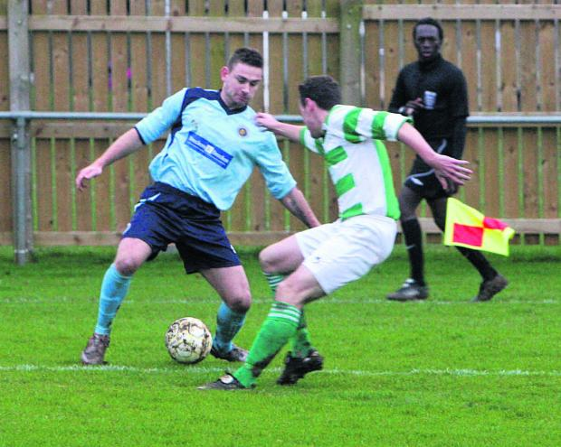 Ardley United's hat-trick hero Ryan Brooks (left) takes on Tom Butler during in the leaders' 3-0 home win against Wantage Town on Saturday