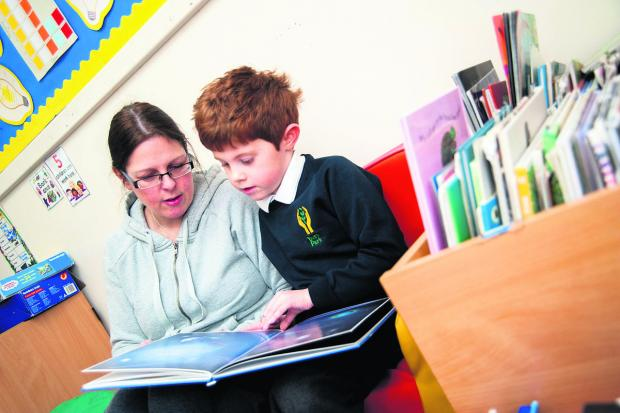 Teacher Tina Woodgate with Dylan Morgan during a reading session. Picture: OX64727 Aimee Kirkham