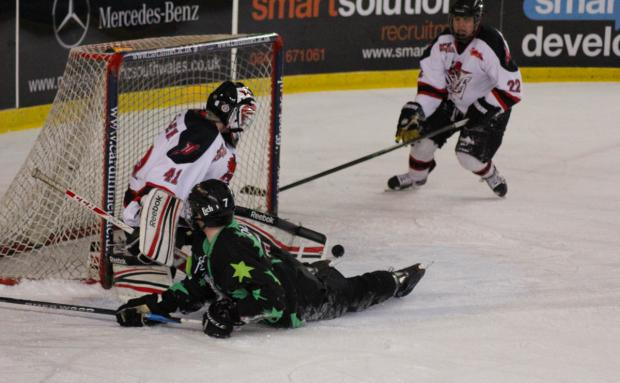 Bicester Advertiser: Oxford City Stars forward Josh Oliver (grounded) goes close late on against Cardiff Devils, but can't get his shot off as netminder Ross Miller stands firm