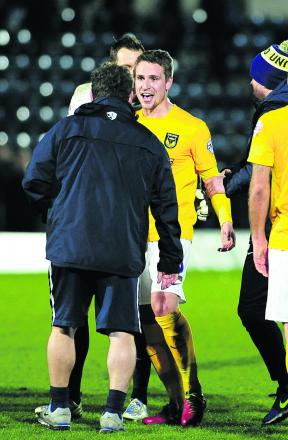 Goal hero Nicky Wroe is all smiles with Mickey Lewis after Oxford United's win at Wycombe