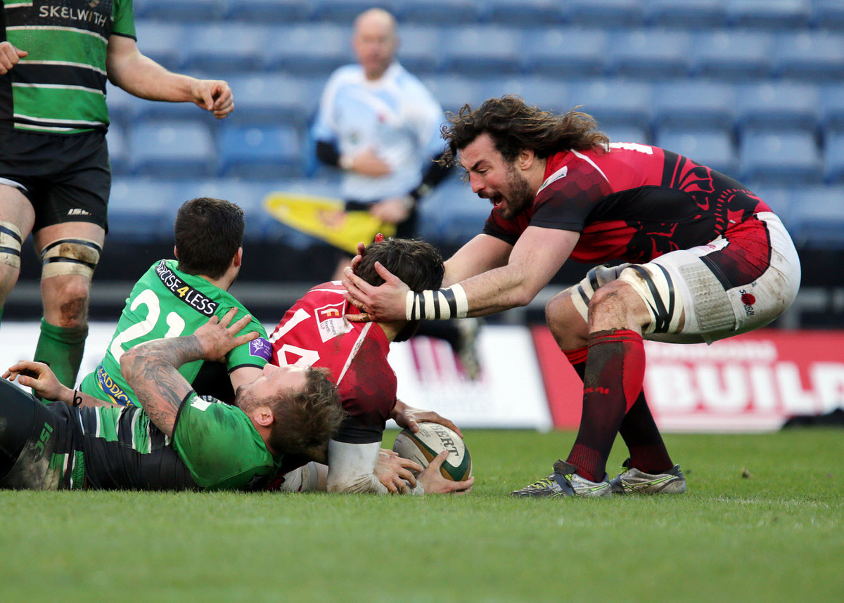 Seb Stegmann is congratulated by London Welsh teammate Ian Nimmo after scoring his side's try