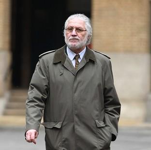Bicester Advertiser: Former DJ Dave Lee Travis arrives at London's Southwark Crown Court, where he is accused of a series of indecent assaults and one sexual assault