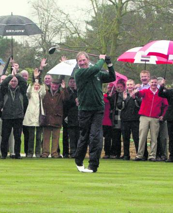 The umbrellas are up as Gordon Neilson (above) drives into office as the new men's captain at Frilford Heath, during a heavy