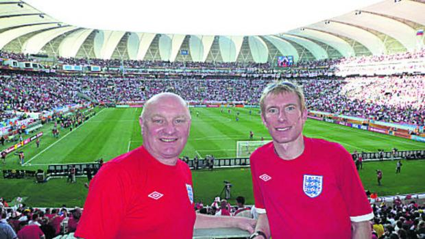 Bicester Advertiser: Mark Heelis and his dad David Heelis watching England at the World Cup in 2010 in South Africa