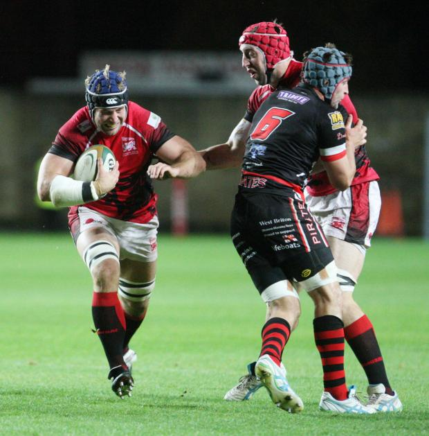 Bicester Advertiser: Richard Thorpe (carrying ball) makes a break for London Welsh as Pete Browne looks on