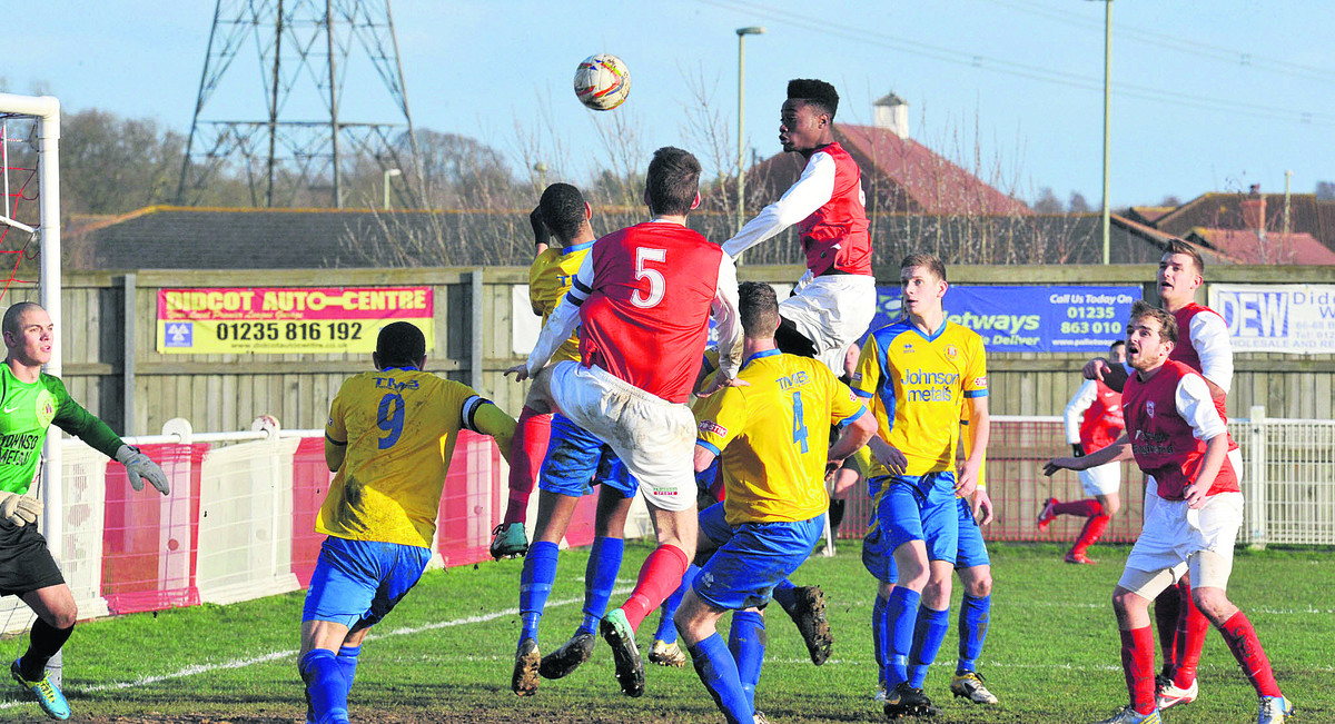 Didcot Town's Germaine Ofori has a header saved