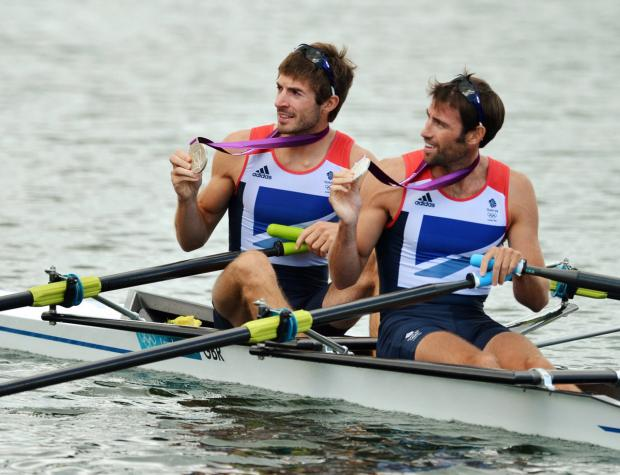 Zac Purchase (left) and teammate Mark Hunter with their double sculls silver medals at the London Olympics