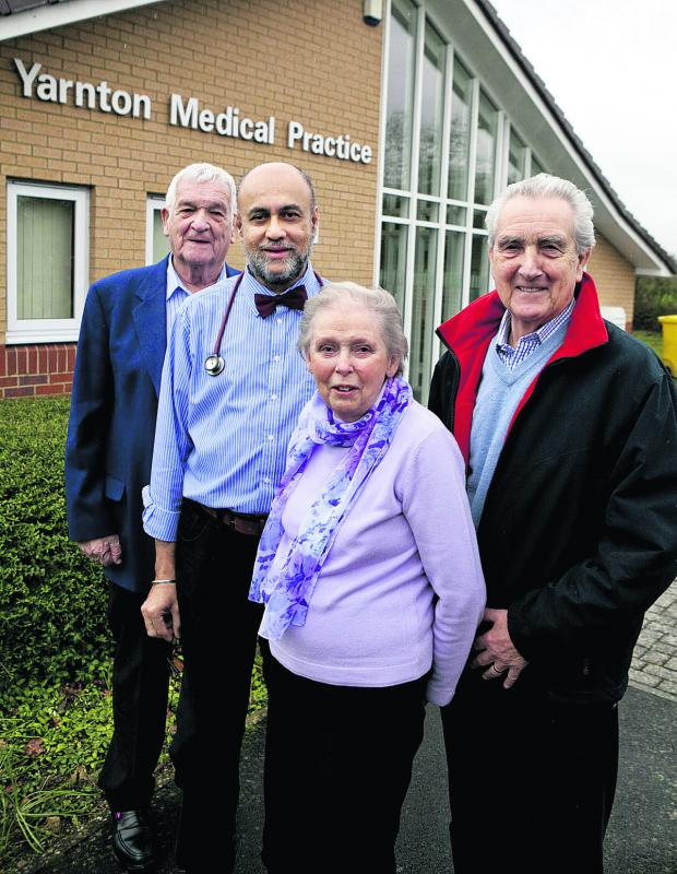 Bicester Advertiser: Dr Kulwant Pandher, second left, with trustees Graham Melhuish, Sheila Westall and John Cherry at Yarnton Medical Practice. Picture: OX64948 Antony Moore